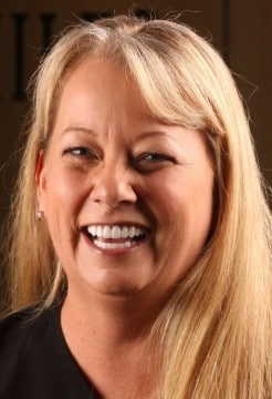 Dr. Chris Hill reconstructed Brenda's bite using orthodontic alignment therapies
